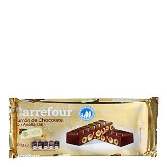 Carrefour Turrón de chocolate con avellanas, almendras y leche. 300 g